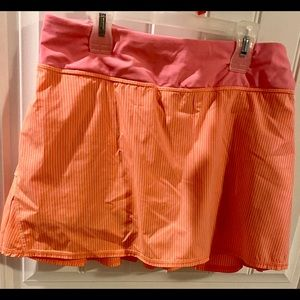 Lululemon golf skirt orange, white and pink size 6